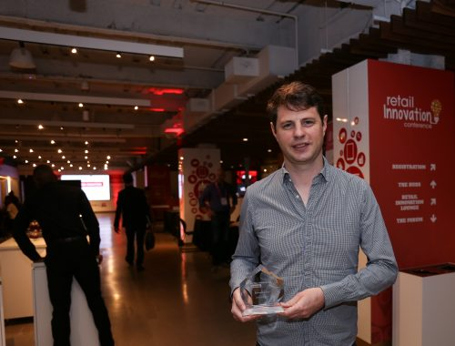 Adore Me's Romain Liot poses with his Retail Innovator Award. He won in the