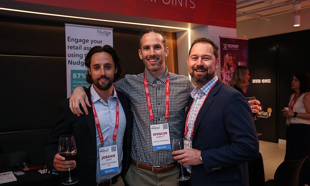 Jordan Ekers, Spencer Barrett and Ryan Poissant enjoy the cocktail reception.