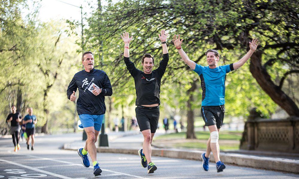 Participants of the 5K Fun Run celebrate crossing the finish line.